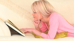 Attractive blondhaired woman reading a book Footage