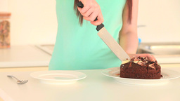 Woman taking a slice of cake Stock Video Footage
