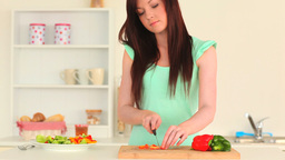 Attractive woman preparing a salad Footage