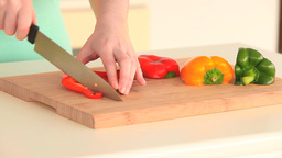 Woman slicing peppers Footage