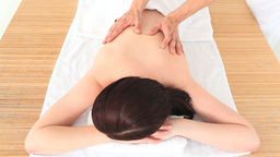 Darkhaired woman having a Spa treatment Footage