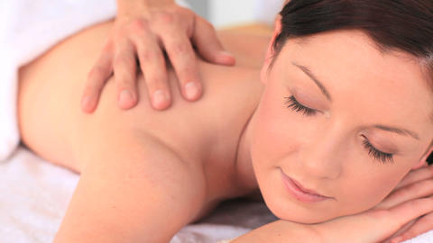 Attractive brunette enjoying a massage Footage