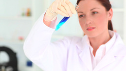 Young scientist conducting an experiment in a lab Footage