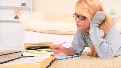 Young blondhaired woman studying Stock Video Footage