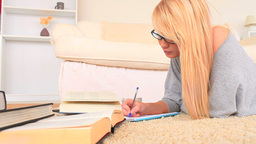 Attractive blonde woman studying Stock Video Footage