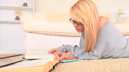 Cute blonde woman studying Footage