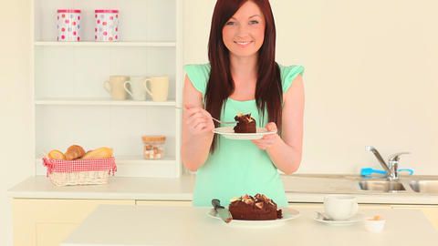 Beautiful brunette eating cake Footage