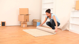 Brunette emptying her place to move house Footage