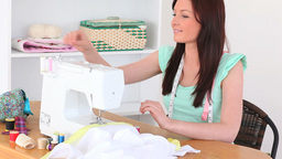 Brunette sewing Stock Video Footage