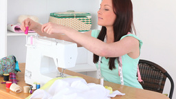 Brunette sewing Footage