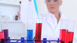 Female scientist conducting an experiment with tes Stock Video Footage