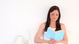 Attractive woman reading a novel Stock Video Footage