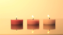 Lighted candles on a yellow background Footage