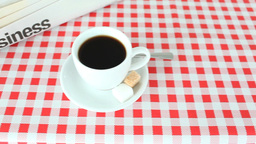 Close up of a coffee with sugars and newspaper Footage