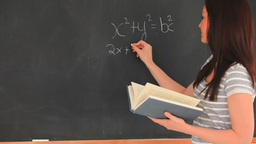 Beautiful woman writing a mathematical formula on Stock Video Footage