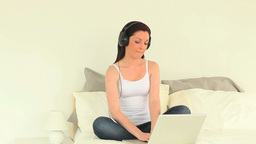 Attractive woman listening to music with headphone Stock Video Footage