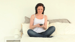Attractive woman listening to music with headphone Footage