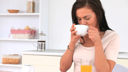 Attractive woman posing while enjoying her breakfa Stock Video Footage