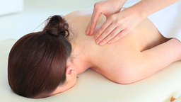 Young woman receiving a massage while lying Stock Video Footage