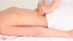 Charming brunette woman receiving a massage while Stock Video Footage