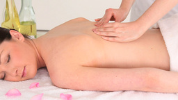 Charming brunette woman receiving a massage while  Footage