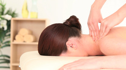 Brunette woman receiving a massage while lying Footage