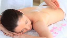 Charming brunette woman receiving an active massag Stock Video Footage