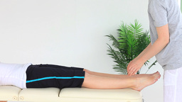 Young woman doing some exercises helped by a physi Stock Video Footage