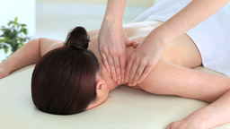 Good looking darkhaired woman receiving a massage  Footage