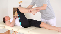 Beautiful brunette woman doing some exercises help Stock Video Footage