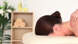 Young darkhaired woman receiving a massage while l Stock Video Footage