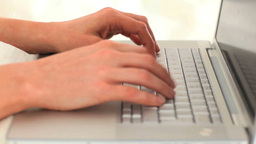 Womans hands typing on a computer Stock Video Footage
