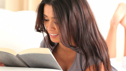 Cute brunette reading a book Footage