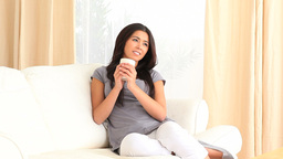 Young woman enjoying a cup of tea Footage