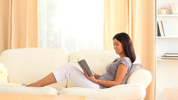 Young woman reading a book Footage