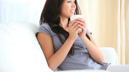 Young woman enjoying a cup of coffee Footage