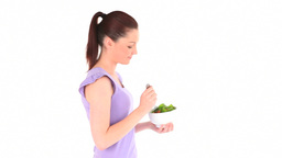 Young brunette eating a salad Stock Video Footage