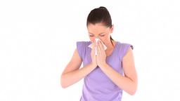 Cute woman sneezing Footage