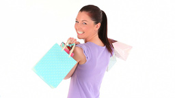 Happy young woman with shopping bags Footage