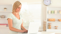Focused woman using her laptop Stock Video Footage