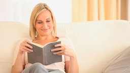 Charming woman reading a book Stock Video Footage