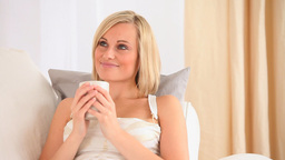 Charming blondhaired woman drinking tea Footage