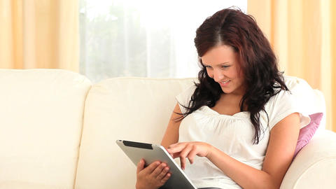 Good looking woman using a tablet computer Footage