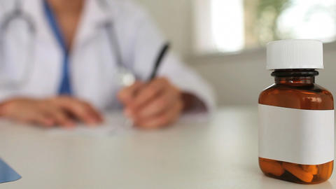 Female doctor writing a prescription Stock Video Footage