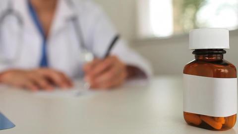 Female doctor writing a prescription Footage