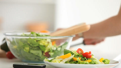 Feminine hands preparing a salad Live Action