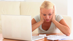 Depressed woman checking her expenses Footage