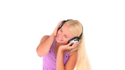 Cheerful woman listening to music Stock Video Footage