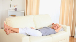 Blone woman lying on a sofa Stock Video Footage