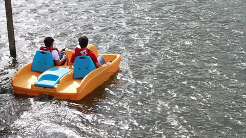 People on Paddle Boat, Next to Fountian Footage